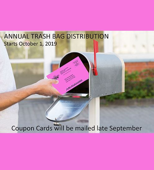 Bright pink bill being taken out of mailbox