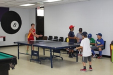 Kids playing in the Deer Park Game Room