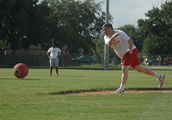 man playing kickball