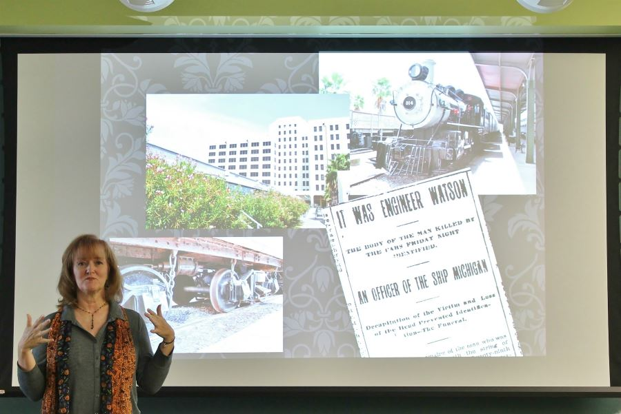 Kathleen Maca, author, presenting in front of project for Haunted Galveston